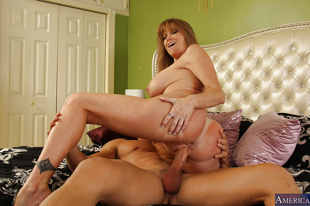 Top-heavy cougar seduces a younger lad to play with his big boner