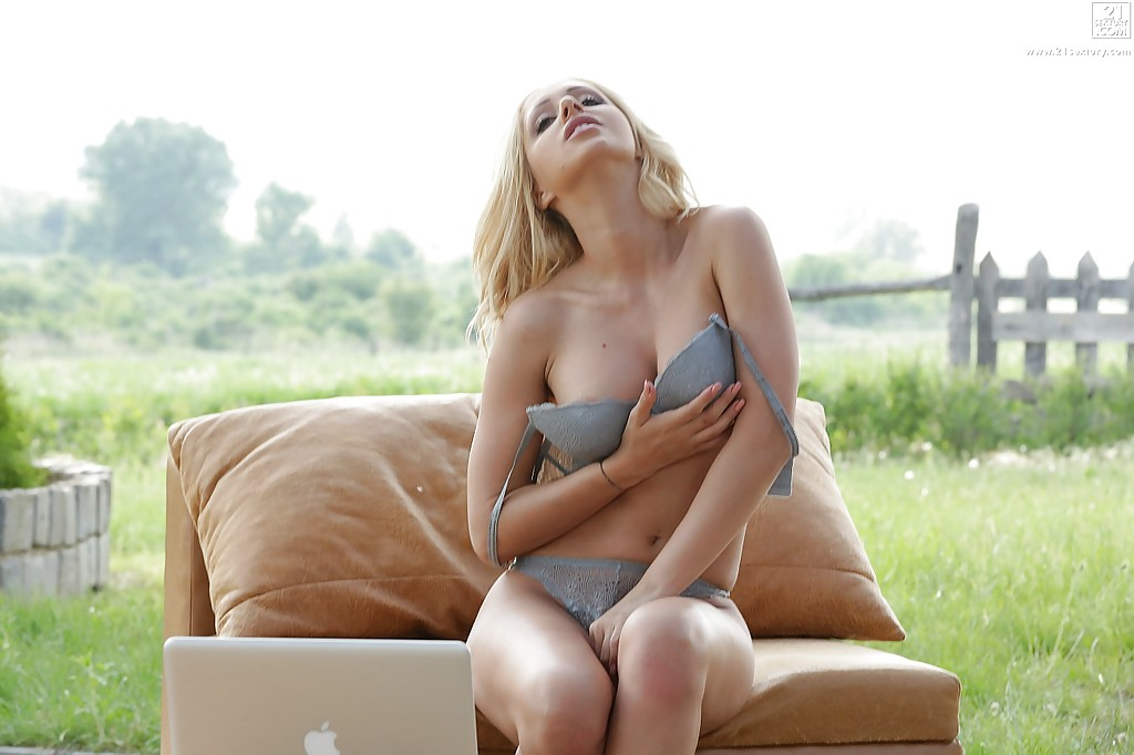 Busty blonde pornstar Melanie Gold removes bra to play with big knockers