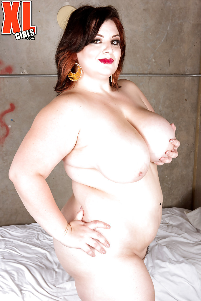 Brunette BBW Lucy Lenore frees huge knockers for nipple play in prison cell