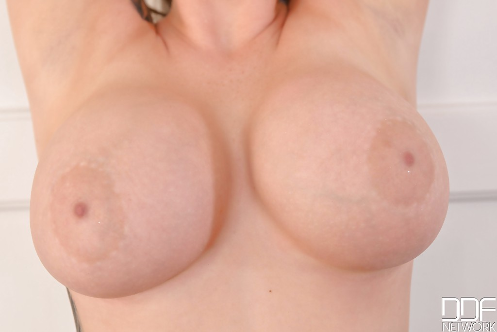 European pornstar Harmony Reigns unleashing large boobs in black nylons