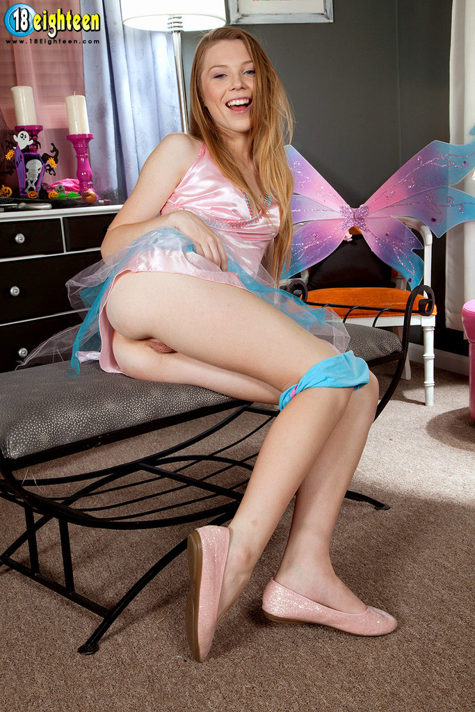 Cute young girl Alice Upton casts aside her cosplay outfit to pose naked
