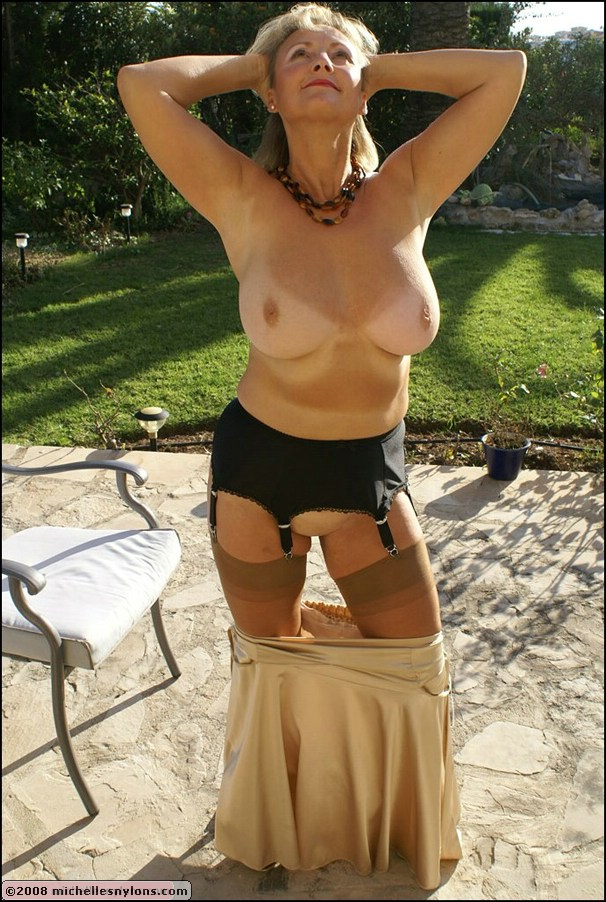 Alluring blonde mature fatty exposes her fantastic big breasts outdoors as she strips
