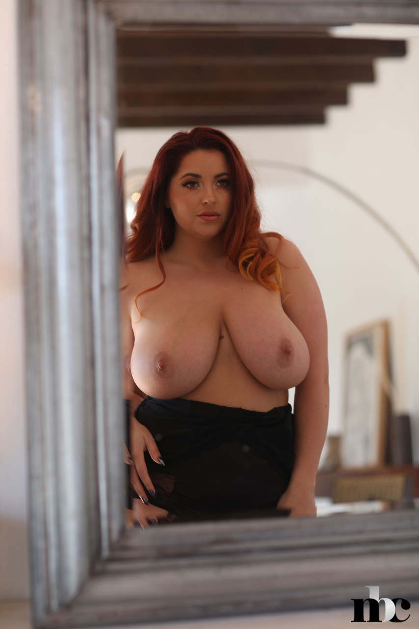 Chubby redhead Lucy Vixen strips in the mirror and shows her huge natural tits 55719443