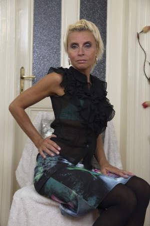 Mature housewife with blonde hair strips to black stockings and high heels