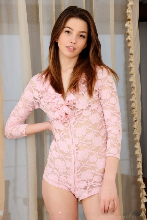Beautiful teen Caralyn unzips her onesie to flaunt her naked body