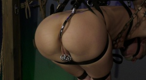 White female Abigail Dupree is affixed in place with an anal hook