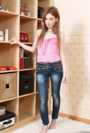 Thin teen Juliya shows her tight slit after wiggling free of her clothes