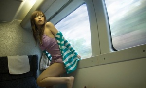 Beautiful teen with Japanese ancestry strikes great solo poses in the nude