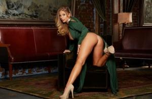 Beautiful blonde Britney Amber crosses her bare legs before spreading her twat