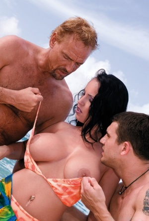 Super busty hot pornstar kneels topless to suck double cock in beach threesome