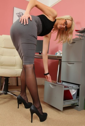 Blonde secretary Lacey Jay bares small tits at work in pantyhose