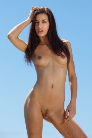 Skinny young Candice Luka stripping bikini to show naked small tits at beach