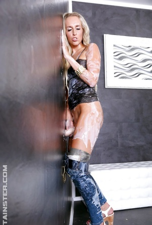 Glam gal has some gloryhole fun with fake cock and gets covered with fake jizz