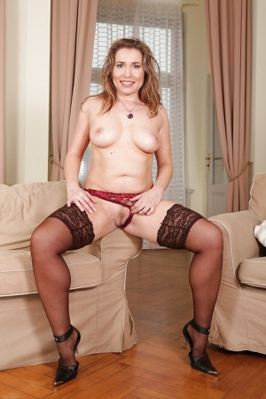 Tempting MILF with fatty ass stripping and spreading her nylon clad legs