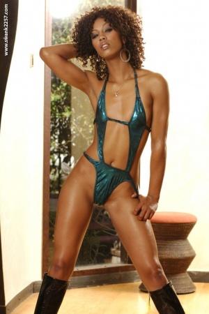 Slender ebony MILF in high-heeled boots slipping off her tiny bikini