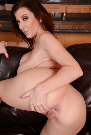 Top-heavy MILF with ample ass undressing and spreading her legs