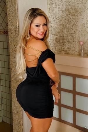 Curvy latina MILF in tiny dress flashing her jugs and teasing her slit