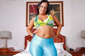 Fatty latina MILF in leggings undressing and exposing her huge butt