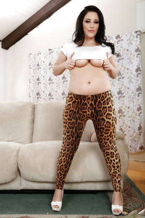 Hot brunette in leopard leggings undressing and squeezing her big jugs