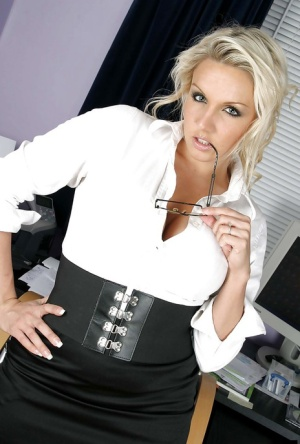 Dannii Harwood is showing her big tits while in her office on work