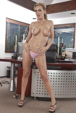 Busty chick is demonstrating her awesome big tits and sweet heels