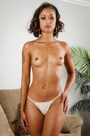 Ebony Skin Diamond is lifting up her dress to show us her black booty