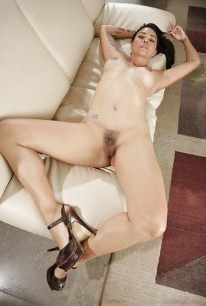 Asian babe Dana Vespoli is lying with spread legs in the bedroom