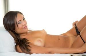 Latina Maya Grand shows us her small but pretty tanned boobies