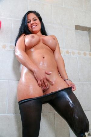 Beautiful curvy Latina babe Missy Maze poses her sexy oiled body