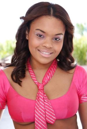 Ebony cutie Izces Divine posing in skimpy schoolgirl uniform outdoors