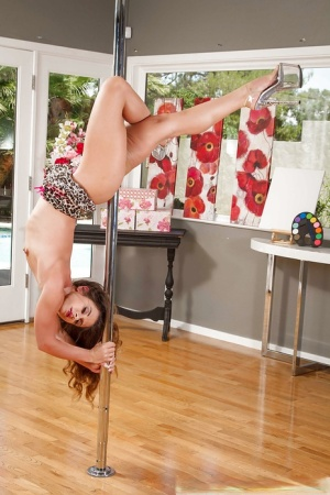 On the stripper pole hottie wife Bentley displays her seduction skills