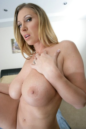 Lusty MILF babe with big juggs Devon Lee strips and fingers her ass