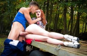 Redheaded Euro teen Ella Hughes blowing a big cock outdoors