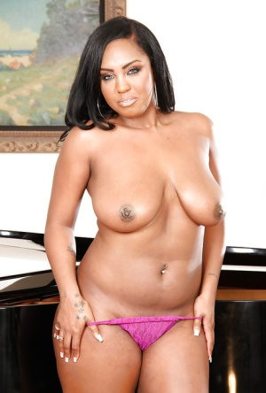 Chesty black model releases huge breasts from bra and exposes shaved pussy