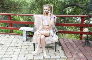 Skinny blonde babysitter Rachel James showing off her flat chest outdoors