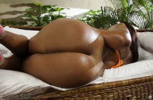 Oiled Brazilian beauty Cris Brasil letting tanned tits free from bikini