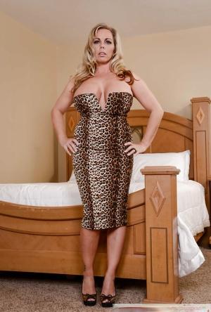 Chunky older blonde Amber Lynn Bach removing cougar print dress