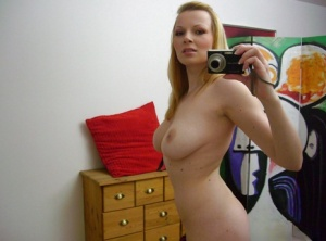 Busty blonde chick Ricky taking self shots in mirror while masturbating