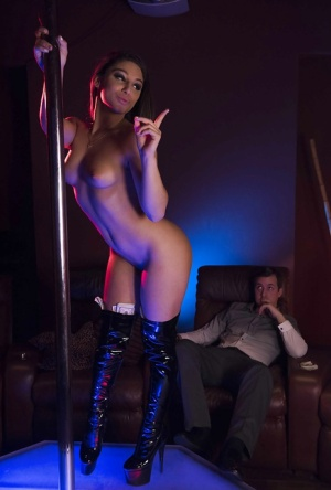 Teen pornstar Abella Danger working stripper pole in long boots for cash