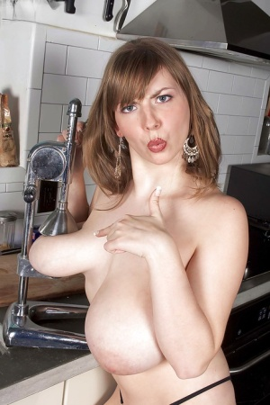 Solo girl Christy Marks revealing massive hooters in kitchen