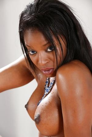 Ebony dime Jasmine Webb revealing big tits and shaved vagina before pissing