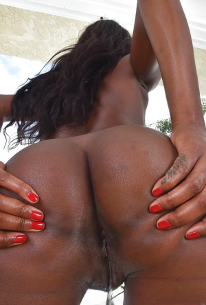 Black babe in denim jeans stripping naked to reveal phat black ass outdoors
