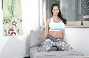 Curvy wife Ava Addams revealing huge MILF tits during babe photo shoot