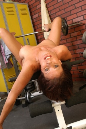 Mature busty woman Vanesa needs to play with her shaved pussy at the gym