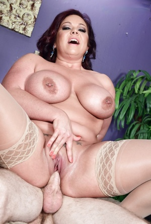 Busty MILF Krissy Rose leads large cock down her fat pussy and throat
