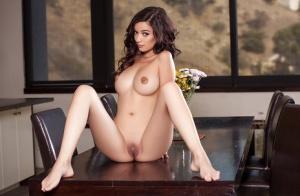 Brunette centerfold model Eden Arya posing naked after bra and panty removal