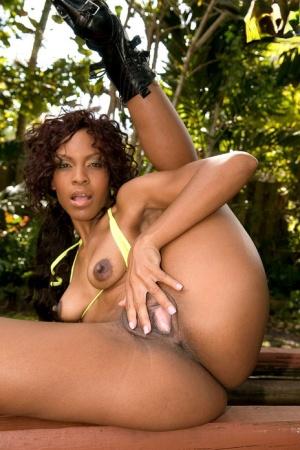 Hot black model Envy Kenya flaunts her juicy butt before masturbating on patio