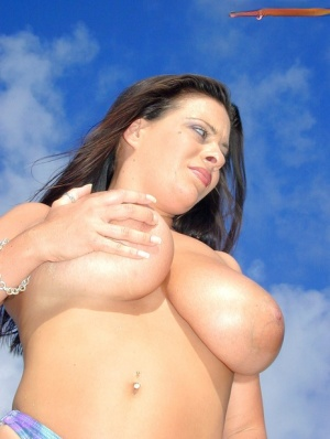 European female Linsey Dawn McKenzie lets her hooters catch rays on nude beach