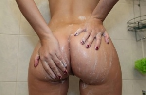 Naked amateur Valentina Nappi soaps up her trimmed twat in the shower