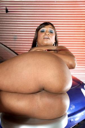Black female Kara Kane flaunts her big booty before sticking a toy in her twat
